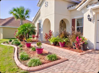 Home with custom concrete garden borders